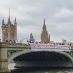Football teams express solidarity with England players through Westminster bridge anti-racism banner